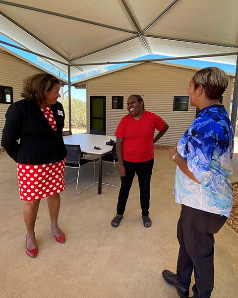 Leanne Liddle with a resident of the Life Skills Camp and Minister Selena Uibo.