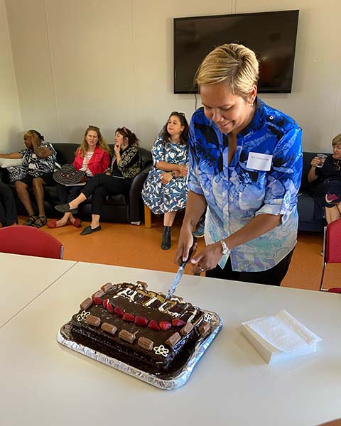 Attorney-General and Minister for Justice Selena Uibo cuts the cake for morning tea.